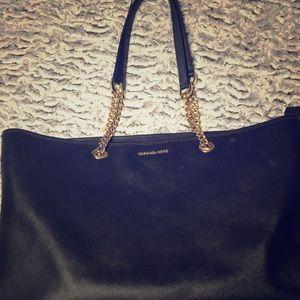 MK black tote with gold chain straps